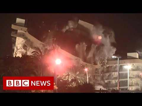 Remaining section of collapsed Miami apartment block demolished as storm approaches  - BBC News