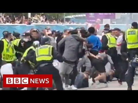 Ticketless England fans break into Wembley for Euro 2020 final - BBC News