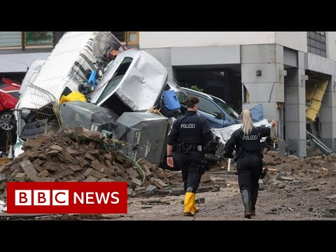 Angela Merkel shocked by 'surreal' floods devastation in Germany - BBC News